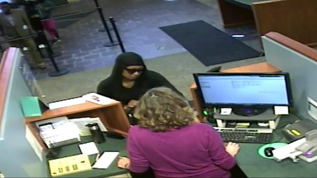 Fridley police are asking for the public's help in identifying the woman in this surveillance image, who they say robbed Firefly Credit Union on Saturday, June 9, 2018. (Courtesy of the Fridley Police Department)