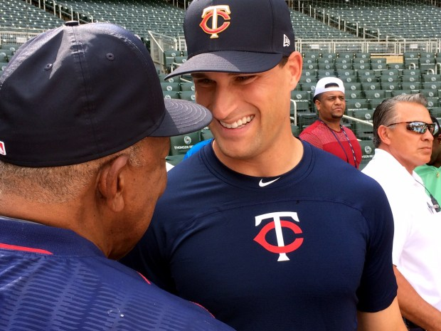 Minnesota Vikings quarterback Kirk Cousins, center, talks to Minnesota Twins great Tony Olivia, left, before taking some swings during batting practice before a Twins game against the Cleveland Indians at Target Field in Minneapolis on Friday, June 1, 2018. Cousins and a handful of teammates took batting practice in front of a crowd that included manager Paul Molitor and former Twins all-star Torii Hunter. (John Shipley / Pioneer Press)