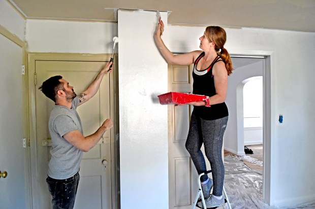 Nick and Ashlea Garrison paint their new home in Dayton's Bluff in St. Paul on Wednesday, June 13, 2018. The first-time homeowners went from attending a homebuying class in early May to closing on their new home in less than a month later, a lightining speed that realtors and lenders say is not unusual in a competitive homebuying market. (Jean Pieri / Pioneer Press)