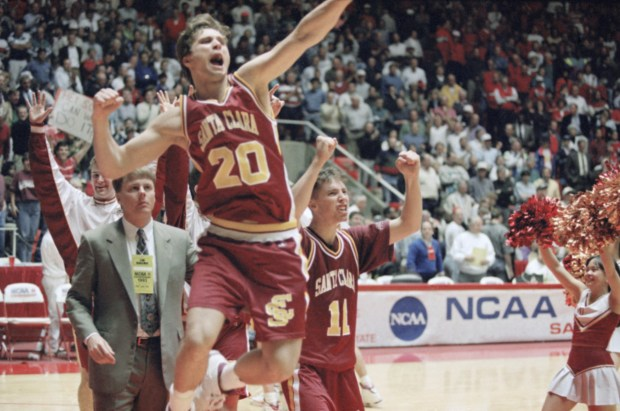 22d6c48b Mark Schmitz (20) and Steve Nash (11) of Santa Clara celebrate upset 64-61  upset win over Arizona during NCAA basketball tournament, Thursday, March  18, ...