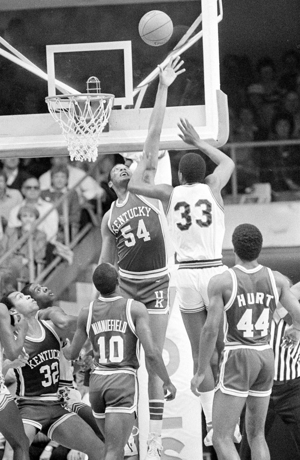 65dc6ad56c3 Kentucky s Melvin Turpin (54) goes high as he tries to block the shot of  Louisville s Charles Jones (33) during first half action in the NCAA  Mideast ...