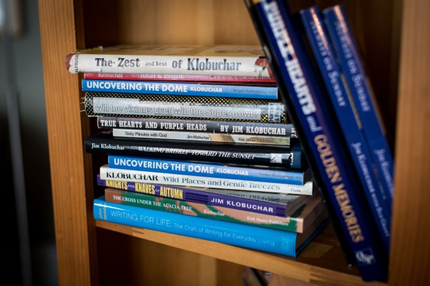 Books written by her father sit on a shelf in Amy Klobuchar's Minneapolis home. (Washington Post photo by Caroline Yang)