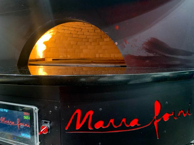 The brick oven for firing up pizzas at Tono Pizzeria + Cheesesteaks in Maplewood. (Nancy Ngo / Pioneer Press)