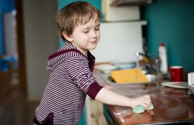 boy wiping counters