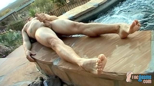Kelly Cooper soaks his feet by the pool (ToeGasms)