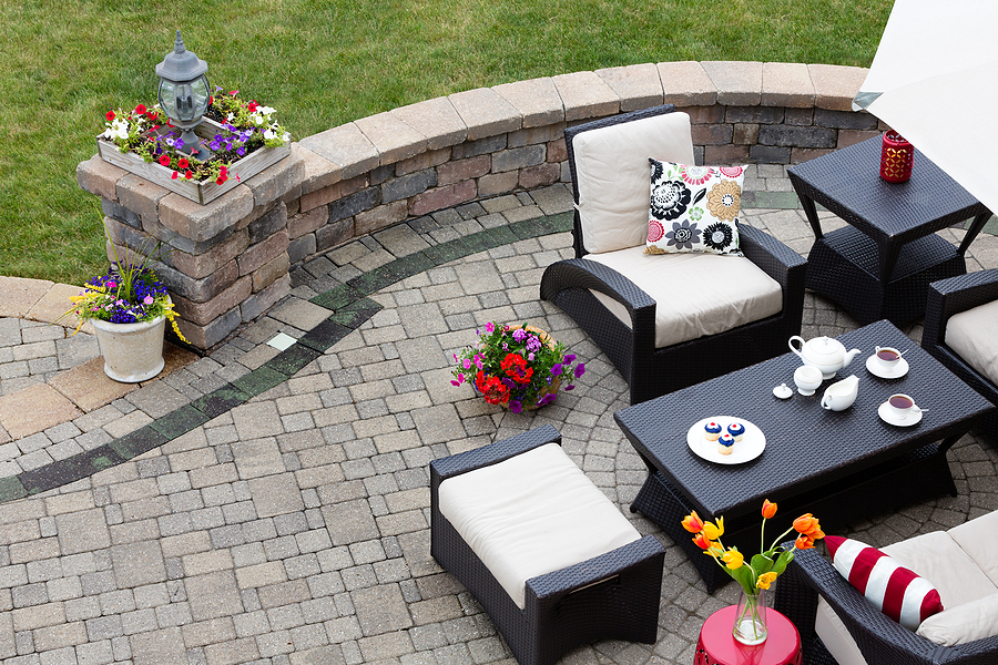brick paver patio vs deck which is