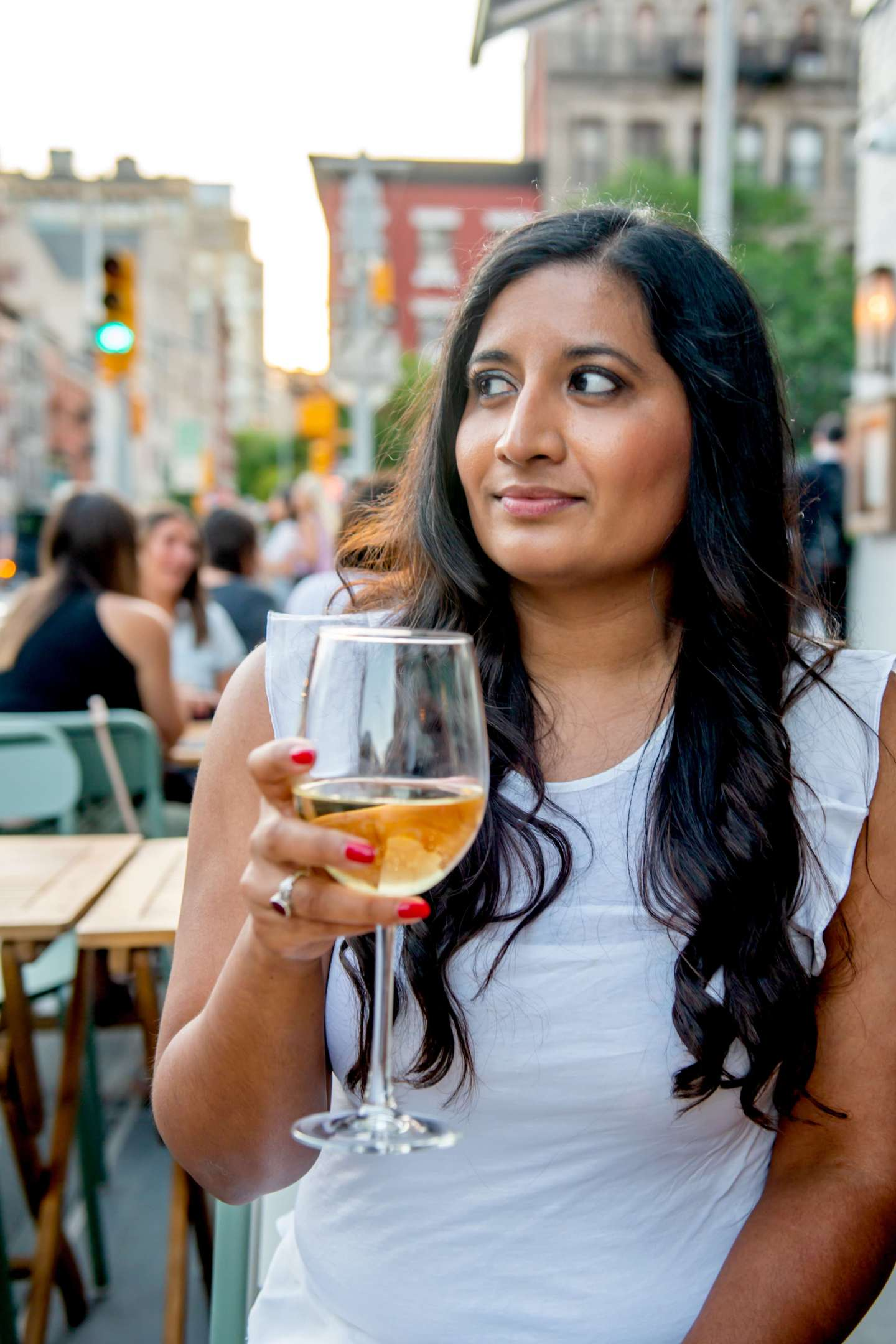 Rosemary's East – Woman Sipping White Wine. Best Restaurants in StuyTown