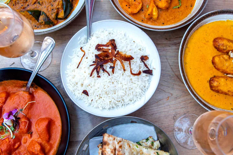 Badshah Butter Chicken, Shrimp, Kofta, Eggplant, Basmati Rice, Garlic Naan and Rose.  Best Indian Restaurants in Hell's Kitchen. Badshah.
