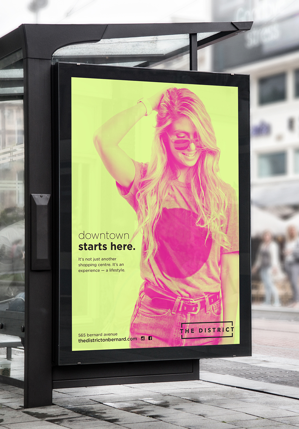 The District on Bernard poster in yellow and magenta, including a photography fashionable woman; highlighting our graphic design services at Twirling Umbrellas