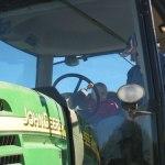 Driving a John Deere tractor.