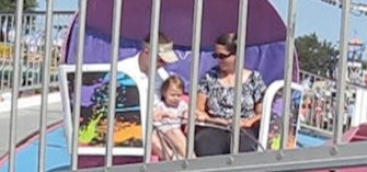 Lily's first Tilt A Whirl Ride