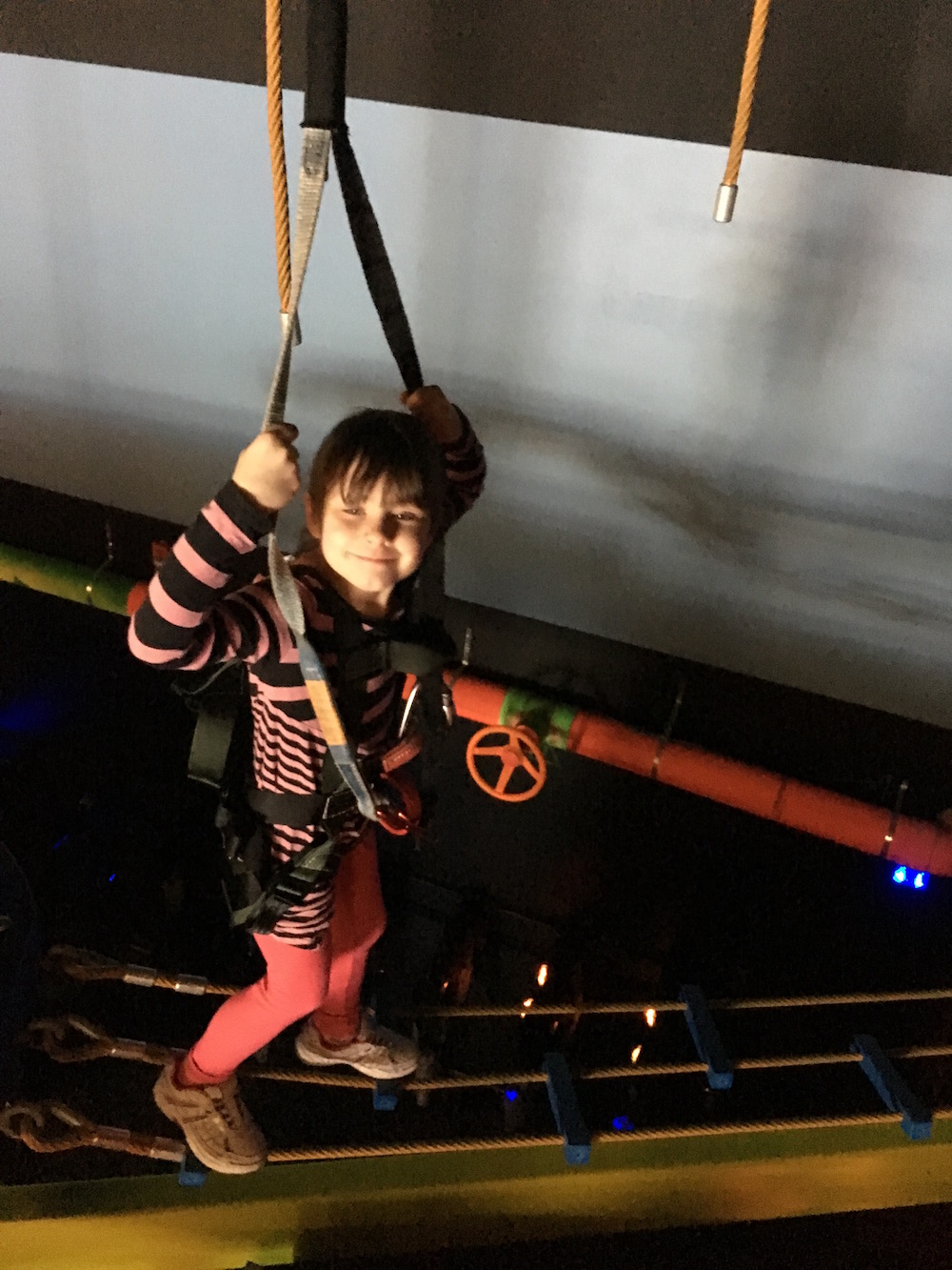 Big smile while walking the ropes course.