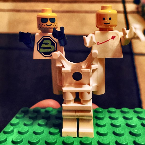Two headed Lego spaceman.