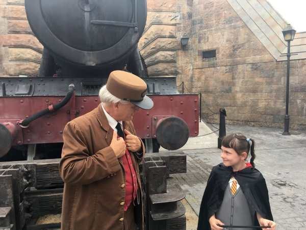 My daughter with the conductor talking
