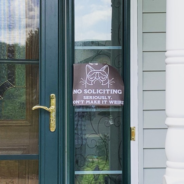Grumpy cat no soliciting sign on our house.