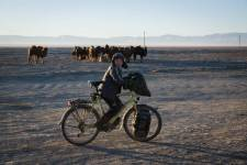 Young Mongolian boy trying Martins bicycle