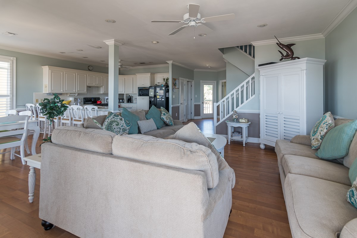 Two Palms Villa Living Area with 2 Couches , Love Seat and Flat Screen TV