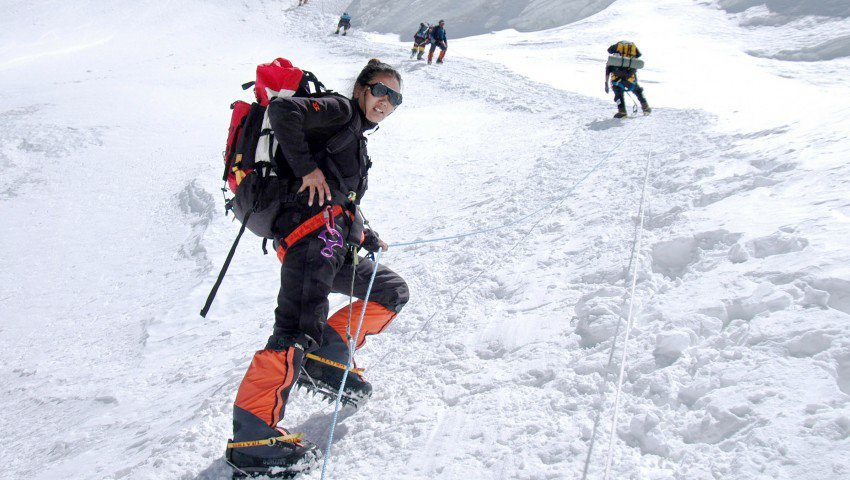 Which female holds the world record for the most Mount Everest ascents? A 7-11 worker from Connecticut