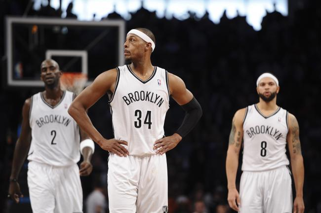 on sale b67af 42082 hi-res-187511983-paul-pierce-of-the-brooklyn-nets-kevin ...
