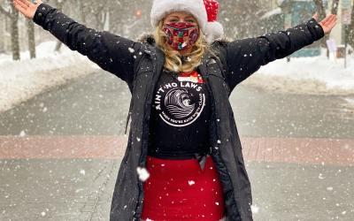 Katie White Claus Explores Troy's Holiday Market