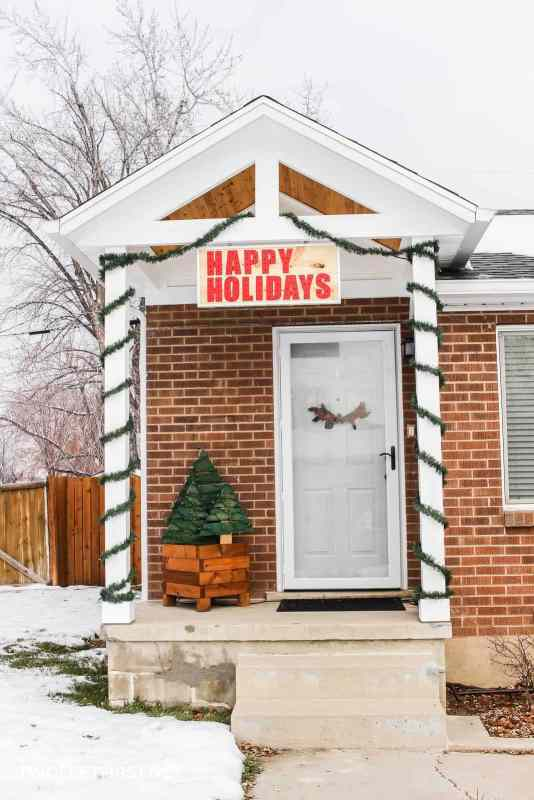 decorate porch with Happy Holidays sign