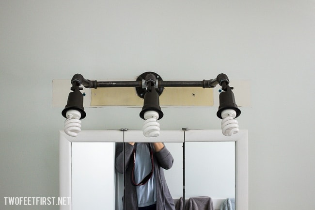 Create a swivel vanity light