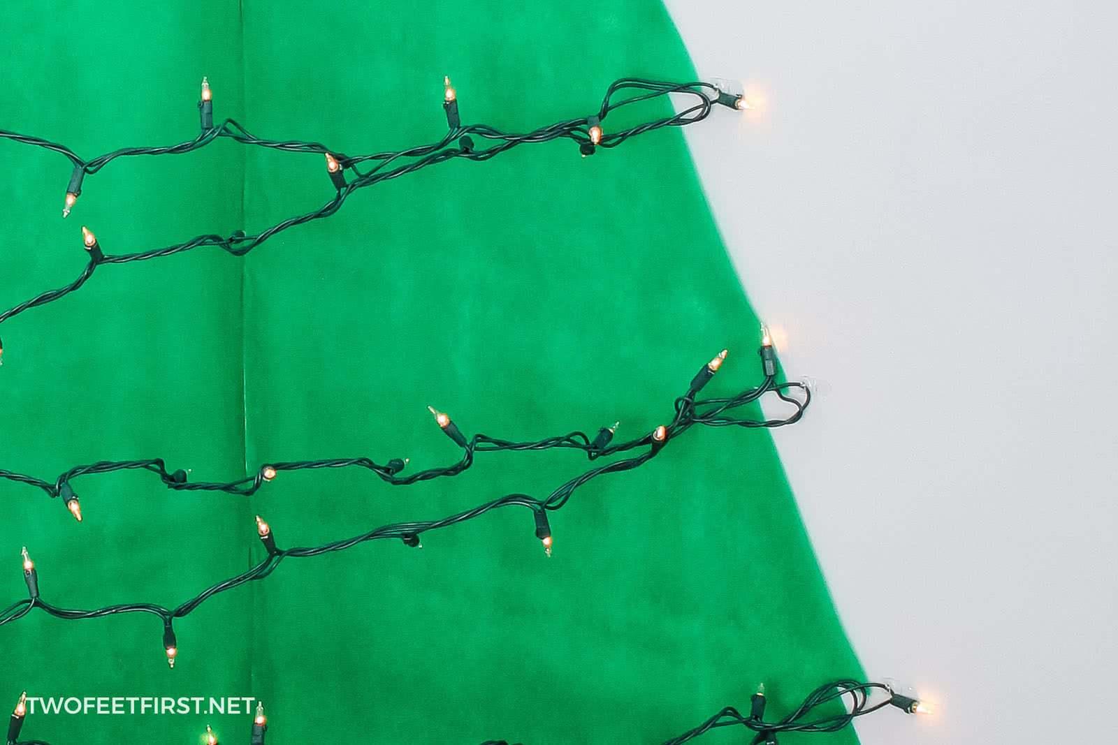 hang Christmas lights on wall