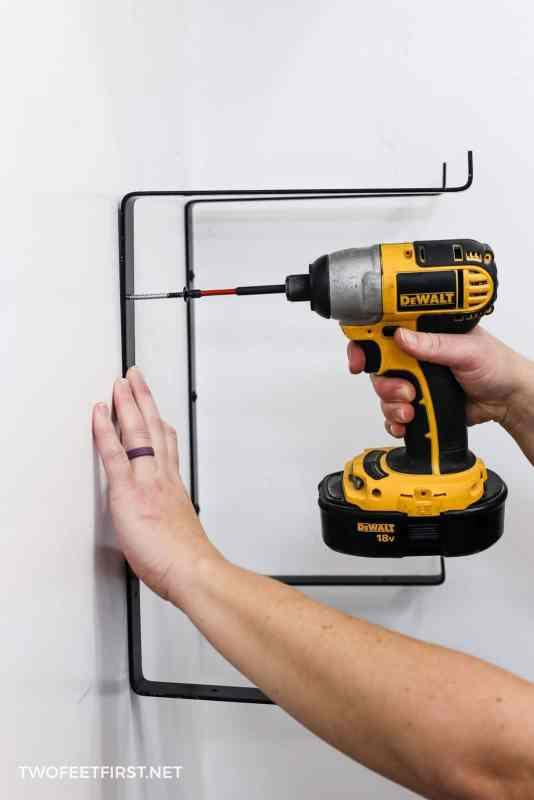 attaching metal bracket to wall