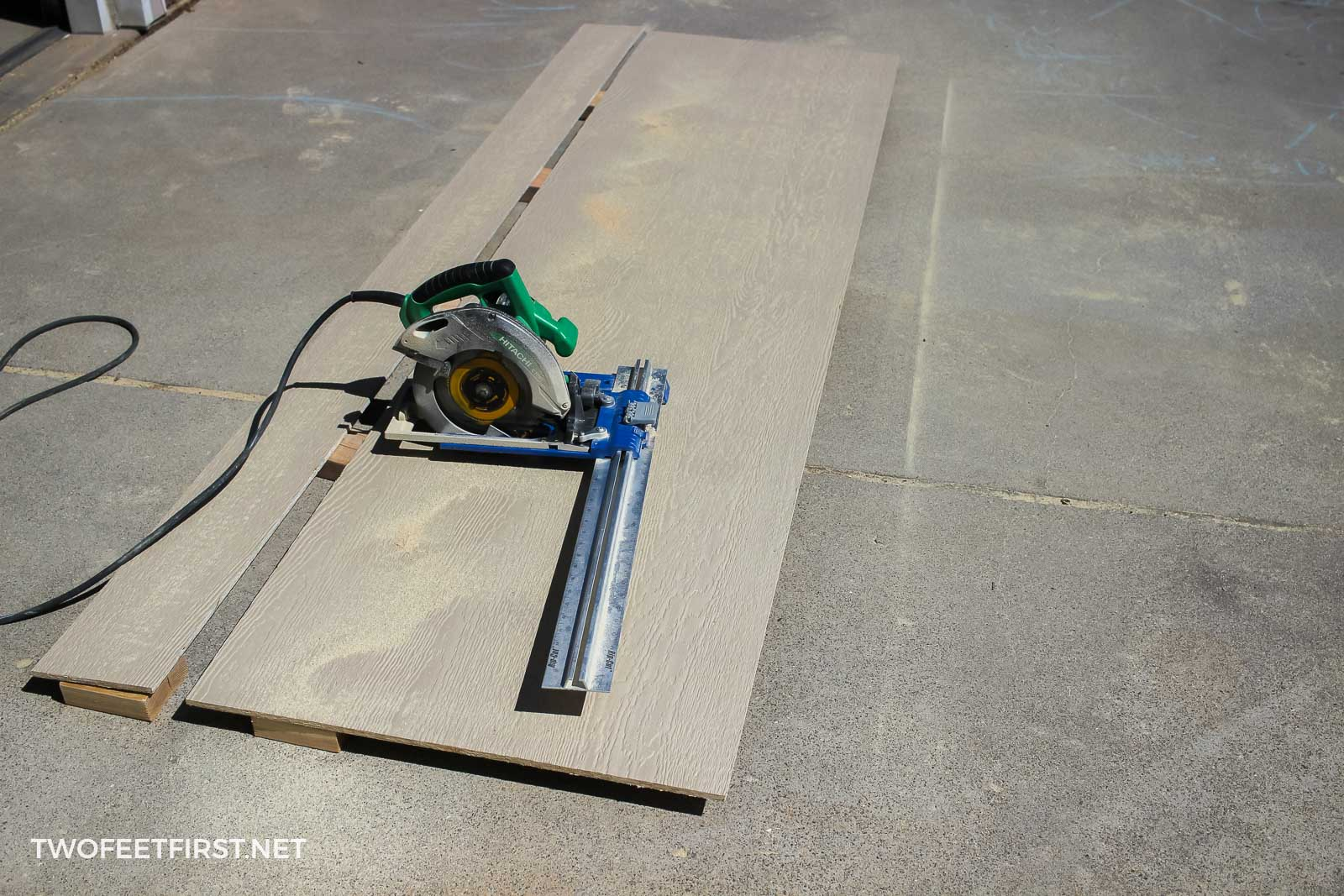 cutting sheet of plywood with saw