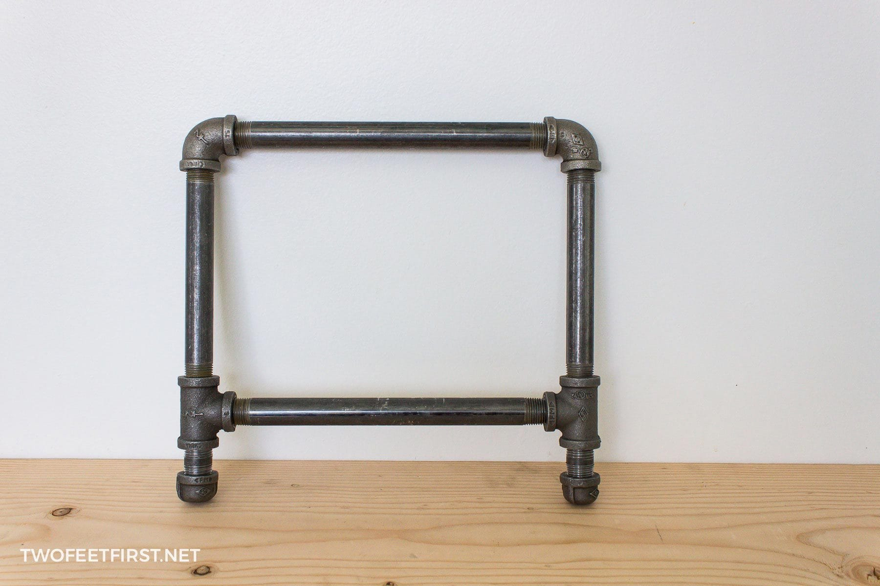 DIY Industrial Shoe Rack with pipe and wood - TwoFeetFirst