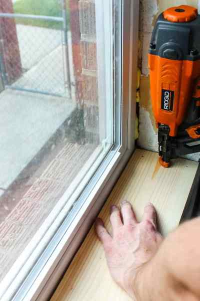 nail window jamb in place