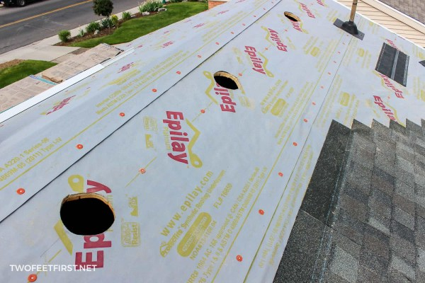 installing new shingles on roof