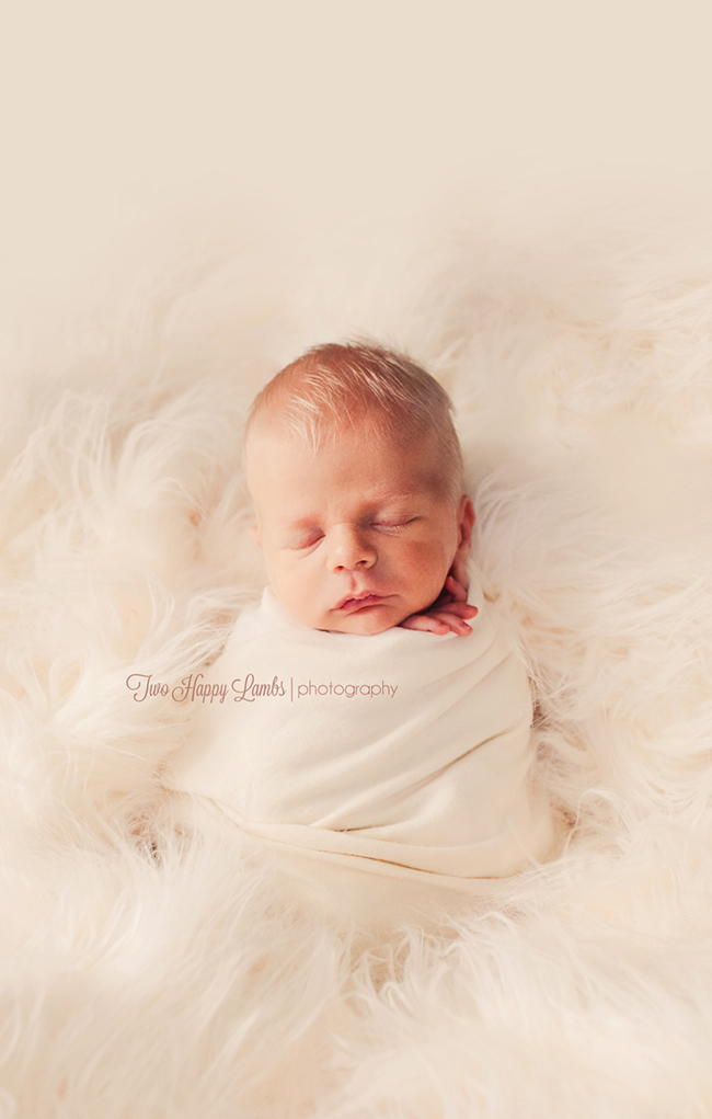 two-happy-lambs-photography-newborn-wrapped-flokati-natural-cream-lashes-details-central-coast-baby-photos-studio-pismo-beach-santa-maria-beullton-california