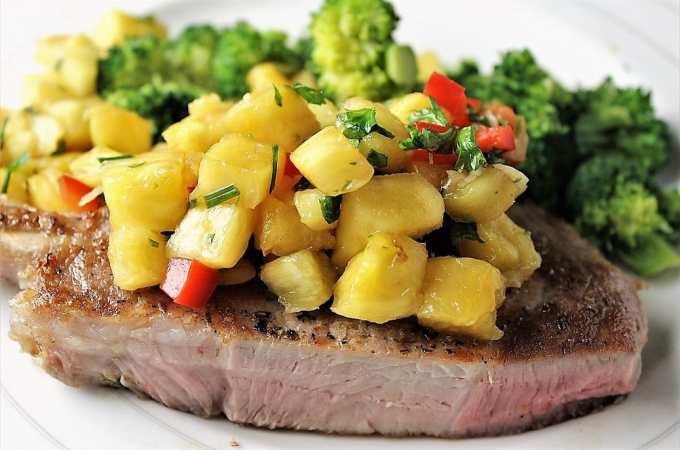 Sous vide pork chops with pineapple salsa. Tender moist pork chops brighten with a fresh salsa