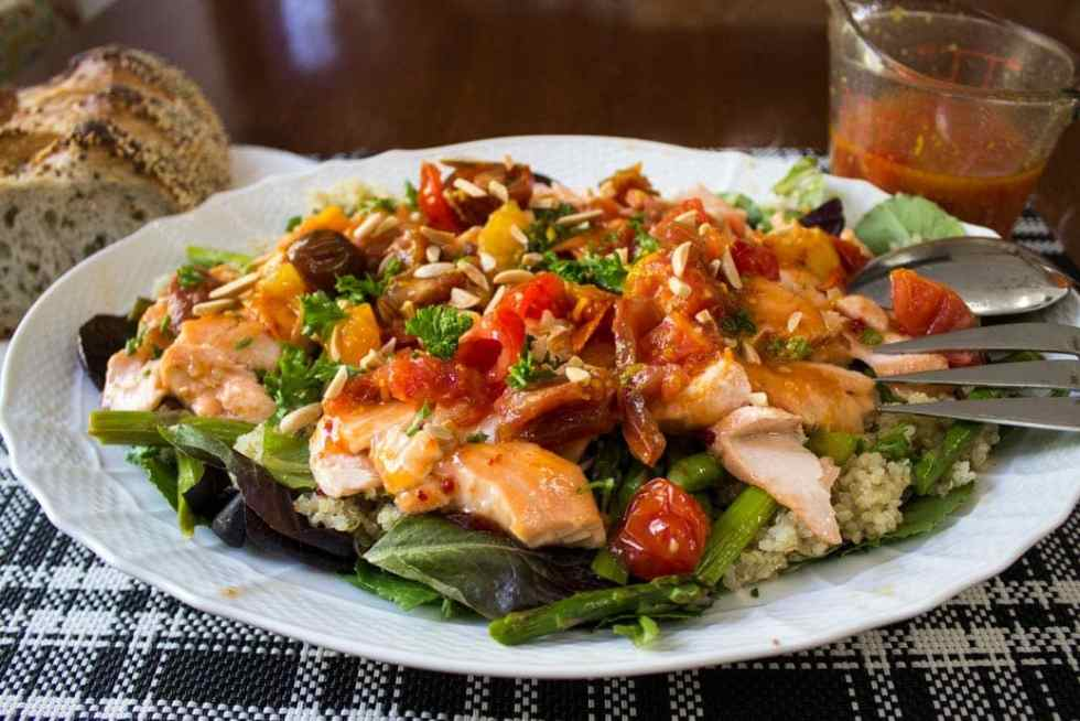 Warm Salmon Salad with Spicy Tomato Citrus Sauce made with greens, asparagus and quinoa
