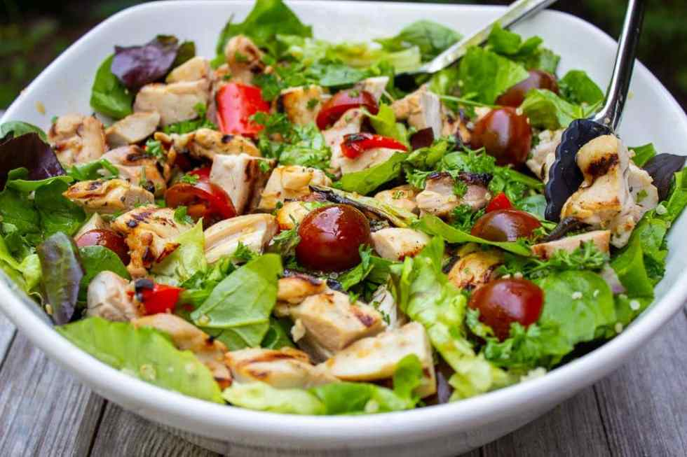 Grilled sesame-lime chicken and quinoa salad. Tender chicken and a mix of fresh and grilled veggies in a tangy sesame dressing.