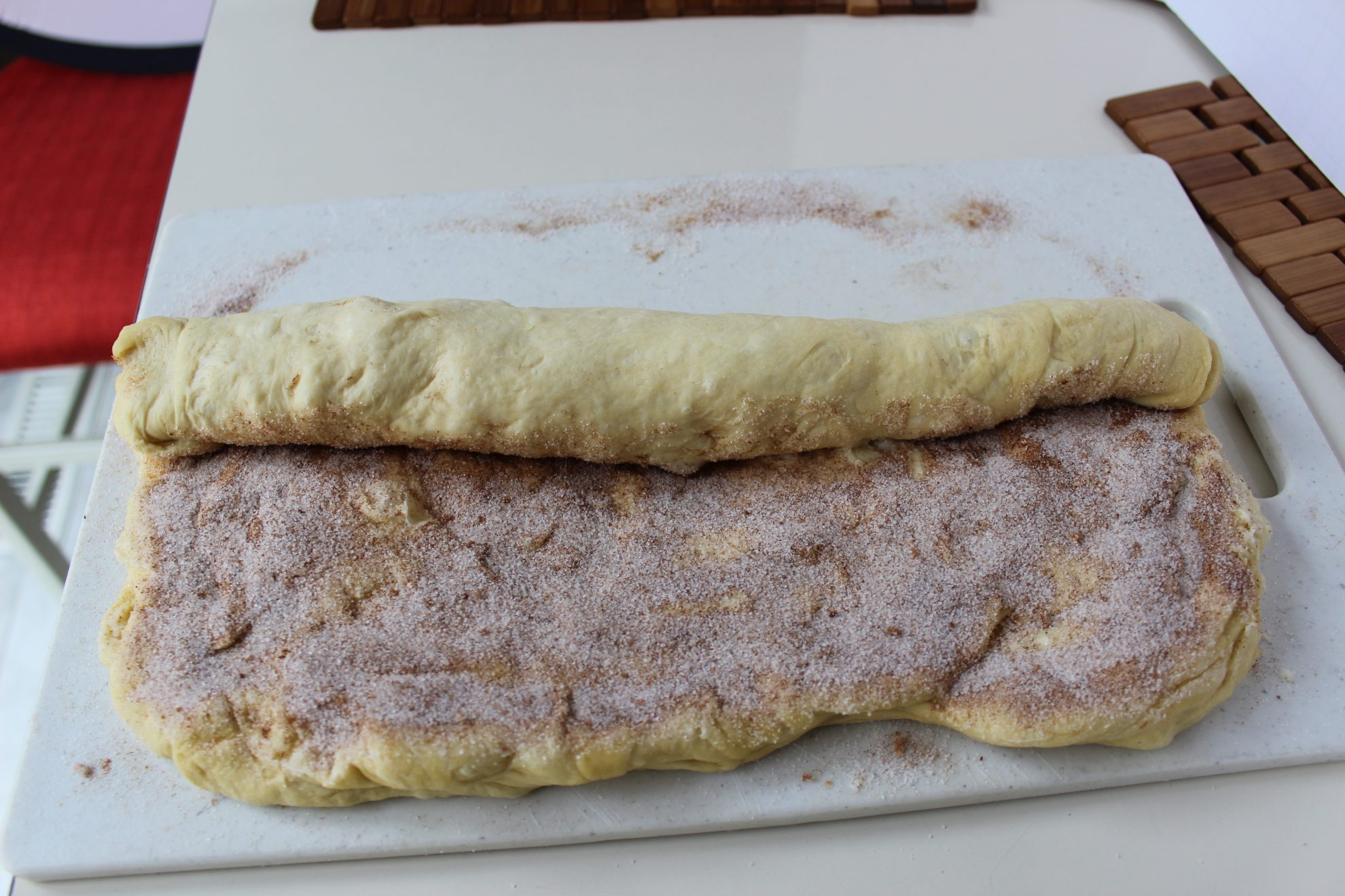 dough rolled lengthwise and pinches to secure