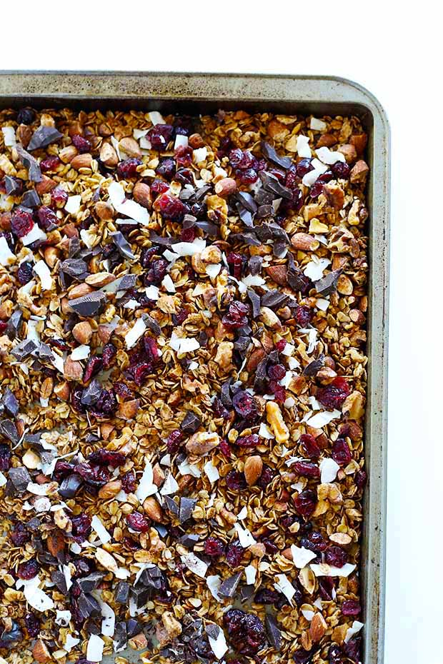 Healthy Dark Chocolate Cherry Cinnamon Granola is the PERFECT snack to toss in your purse for on-the-go or top with milk for a breakfast! quick and easy! Vegan+Gluten Free