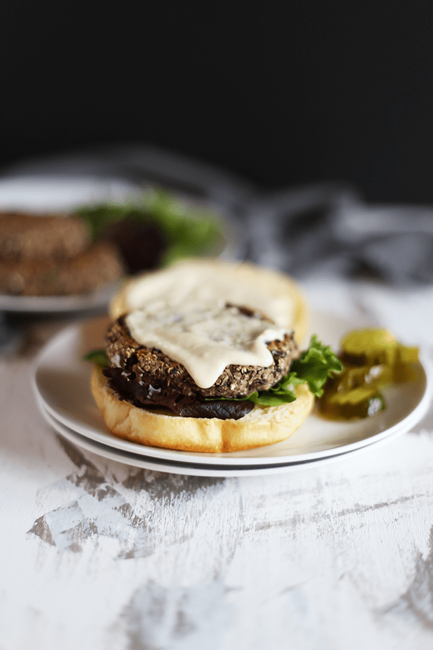 These 5 Ingredient Spicy Black Bean Jalepeno Burgers are quick and easy to make paired with a tahini lime sauce , healthy, VEGAN and GF! | TwoRaspberries.com