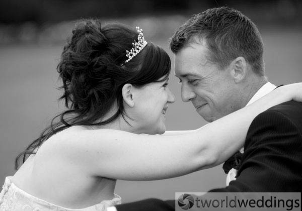 Happy couple photographed at their wedding by wedding photographers TWorld Weddings