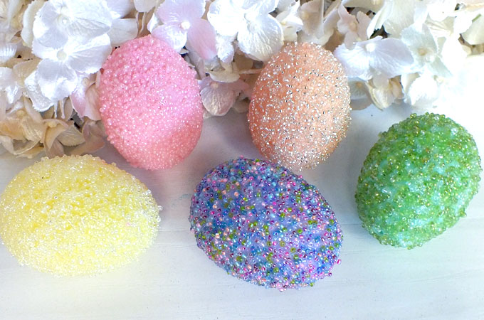 Beaded Easter Eggs - Take those plastic Easter Eggs to the next level with our embellished Beaded Easter Egg Tutorial. These special Easter Eggs will really stand out from your other Easter Decorations. Follow us for more great Easter Craft Ideas.