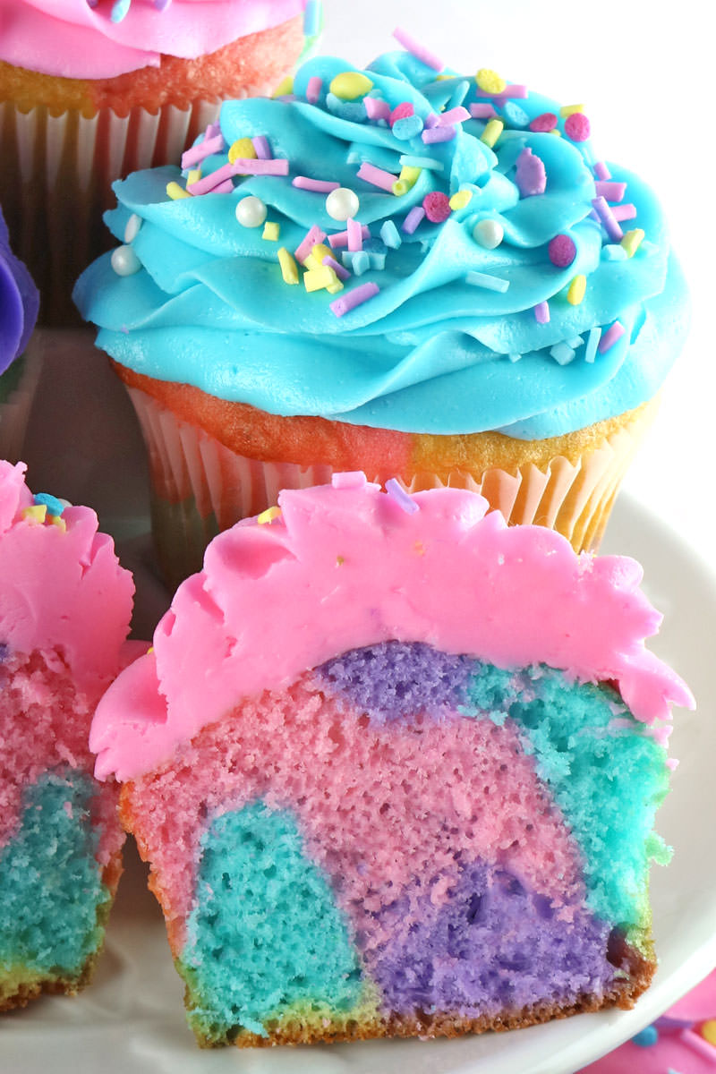 Celebration Marble Cupcakes - a beautiful and colorful cupcake that would be a cupcake recipe for a Unicorn Birthday Party, a Brunch, a Baby Shower or just a random Wednesday. Cupcakes never looked so good or were so easy to make. What a fun and delicious homemade cupcakes. Pin these beautiful Marble Cupcakes for later and follow us for more fun Cupcake Recipe Ideas. #CupcakeRecipes #UnicornCupcakes #Cupcakes #MarbleCupcakes