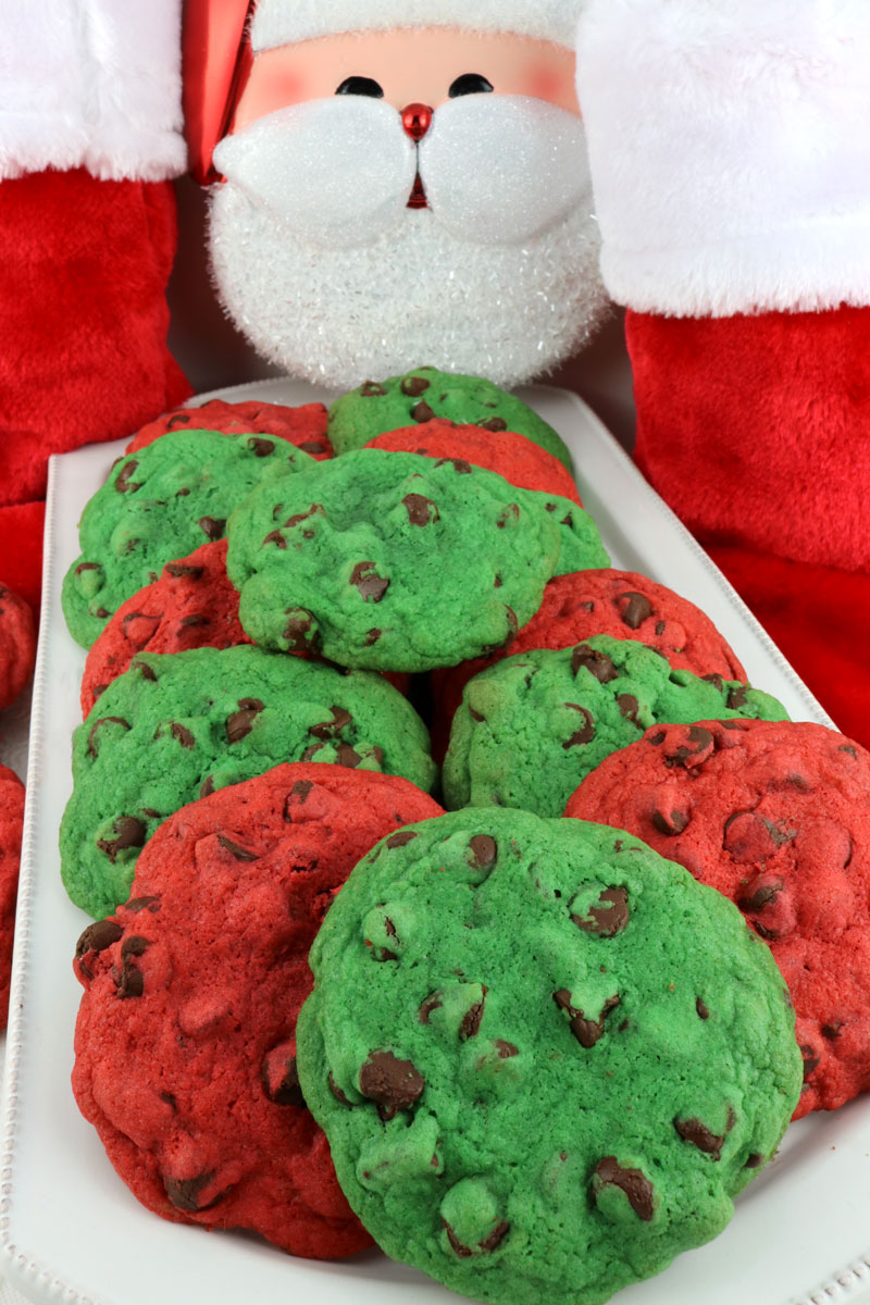 These yummy and fun Christmas Chocolate Chip Cookies are as pretty as they are delicious. What a great dessert for a Christmas Cookie Exchange, a holiday gift for a neighbor or co-worker or just as a special Holiday treat for your family. Merry Christmas!
