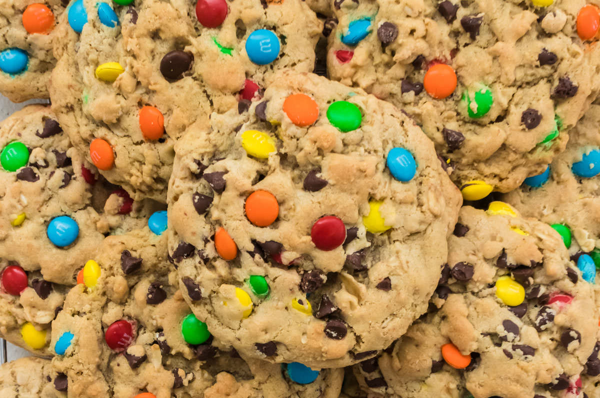 Close up on a stack of Monster Cookies on a white surface.