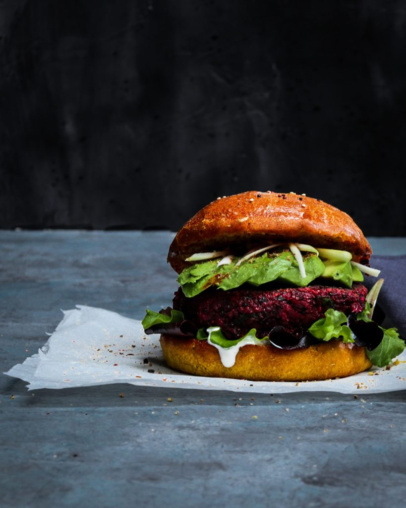 Delicious vegan Red Beet, White Bean &Quinoa Burger with Avocado
