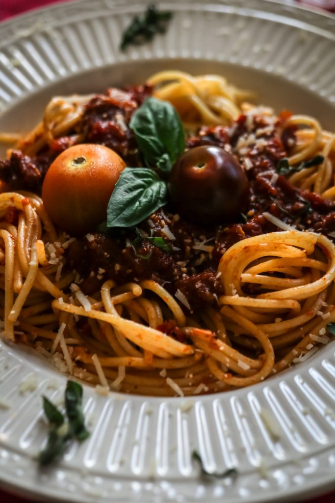 excerpt of the bolognese pasta on a white plate
