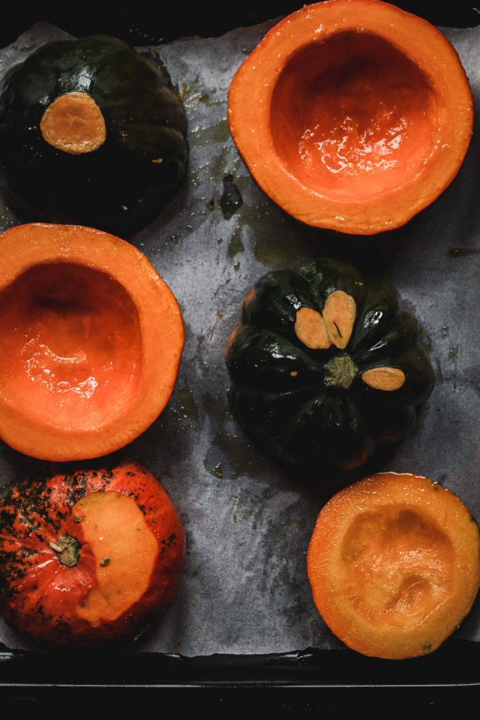 baked pumpkin halves on a baking sheet , pumpkin recipes , risotto recipes, holiday recipes