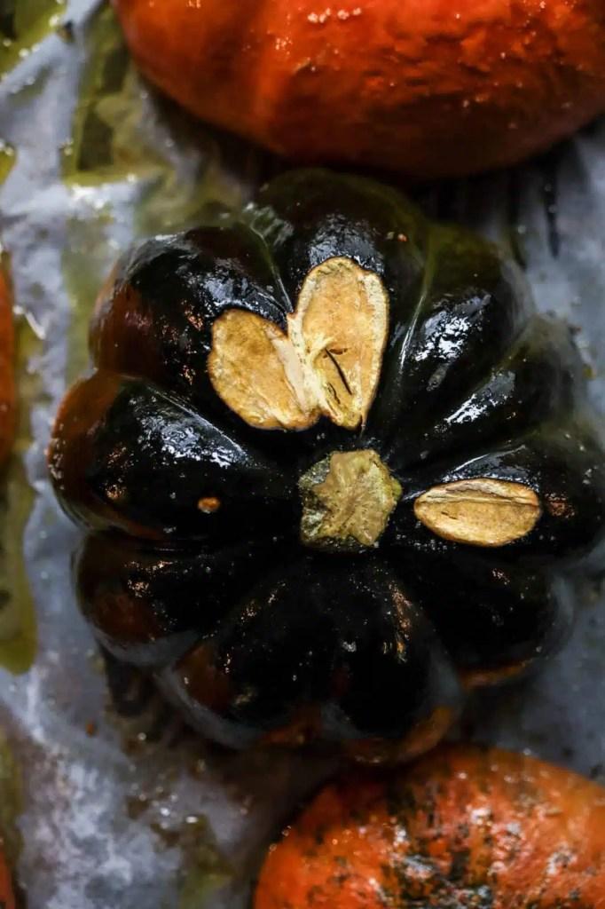 baked pumpkin halves on a baking sheet, pomegranate recipes, pumpkin recipes