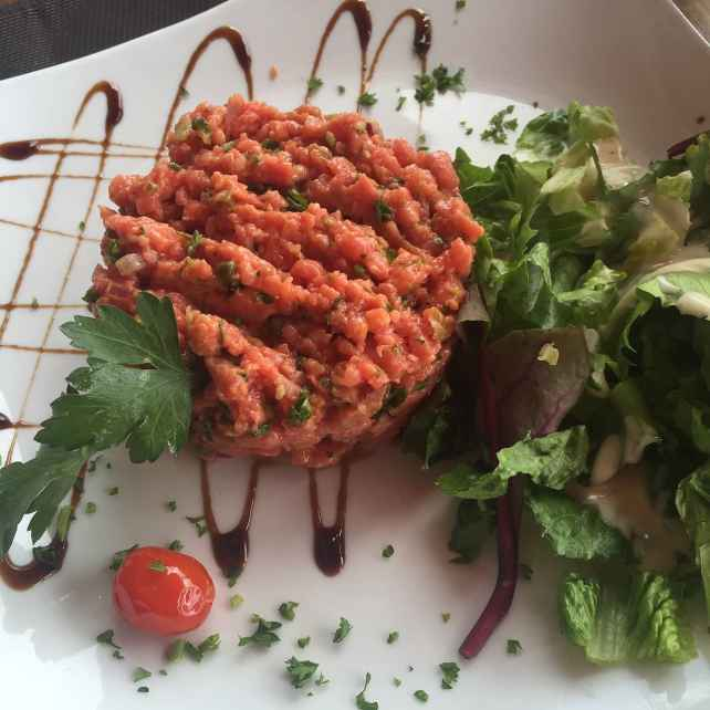 "The beef tartare here is so good. It's hard to really tell in this picture, but the portion is huge! - ""Our Five Favorite St. Martin Restaurants"" - Two Traveling Texans"