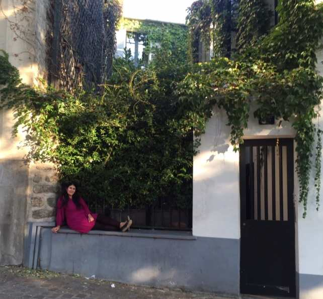 "Anisa hanging out in the Montmarte neighborhood in Paris during her October 2015 trip - ""Our 2016 Travel Wish List"" - Two Traveling Texans"